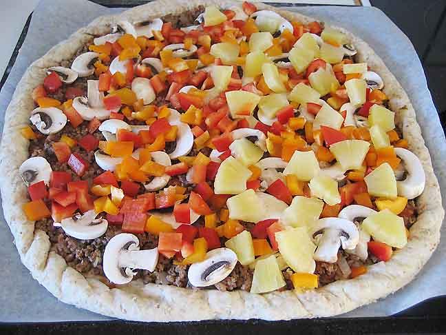Fyldet på pizzaen